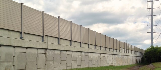 Structure-mounted-sound-wall-on-retaining-wall