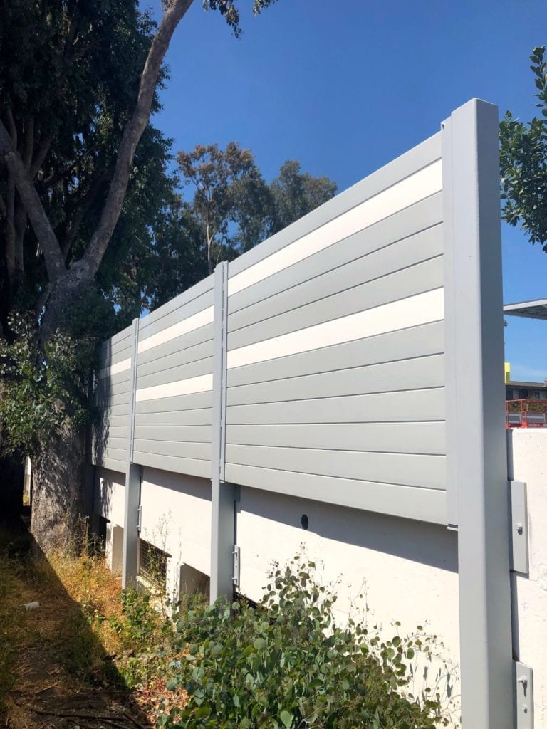 Exterior detail view of sound barrier wall mounted to parking structure